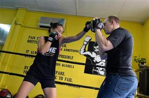 Asian cage-fighter strikes blow for region's women