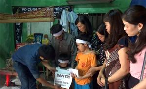 Donation to two boys in Ha Tinh