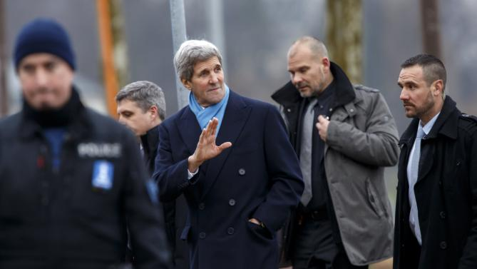 U.S. Secretary of State John Kerry, center, returns to his hotel after walking on the bank of Lake Geneva, following a bilateral meeting with Iranian Foreign Minister Mohammad Javad Zarif for a new round of nuclear talks in Geneva, Switzerland, Monday, Feb. 23, 2015. (AP Photo/Keystone, Salvatore Di Nolfi)