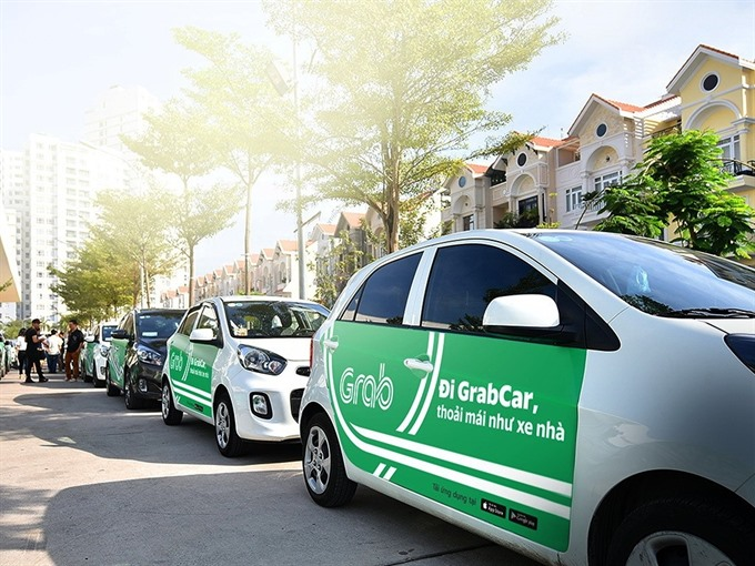 Vietnamese taxi company sues Grab for unfair business