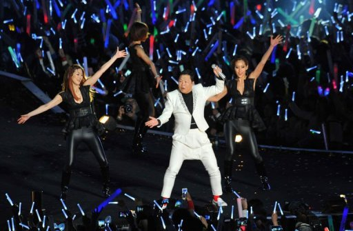 Gangnam Style star Psy (C) performs during his concert Happening in Seoul April 13, 2013