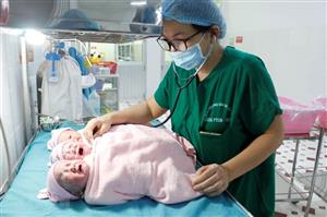 Doctors save woman pregnant with triplets