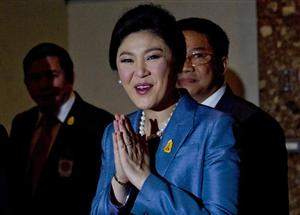 Court forces out Thai leader, part of her Cabinet