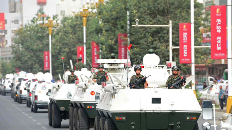 Security forces participating in a military drill in Hetian, northwest China's Xinjiang region, June 6, 2014