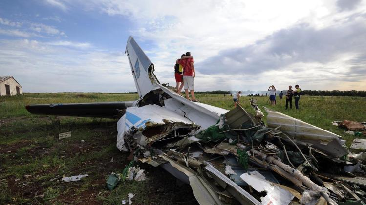 the wreckage of a The Wreckage of a Ukrainian AN-26 military transport plane in the village of Davydo-Mykilske, east of Lougansk on July 14, 2014 after it was shot down by a missile
