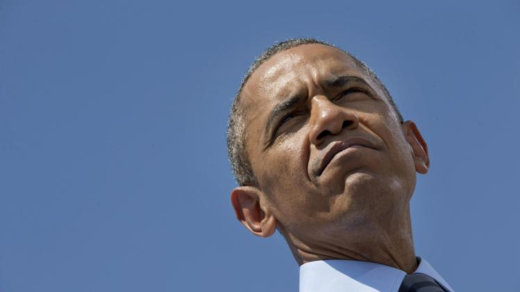 Obama warns Russia, Ukrainian separatists over downed airliner