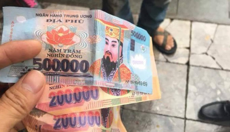 Two Spanish Tourists Have Complained About Being Given Votive Money As Change By A Cyclo Driver In Hanoi