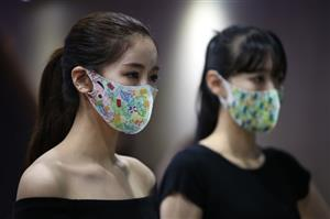 Colourful face masks gain popularity in South Korea