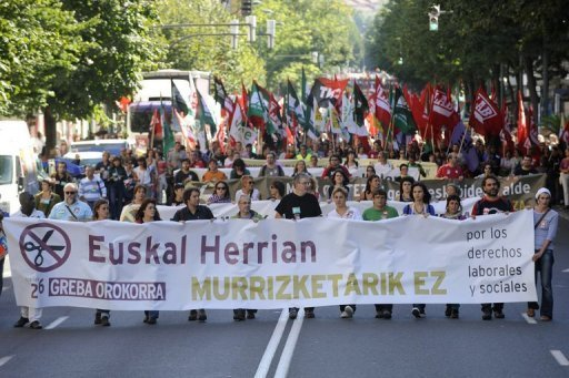 Spain totters on edge of bailout as debt soars