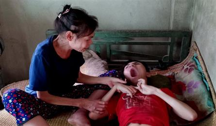 Ailing poor woman takes care of cerebral palsy son