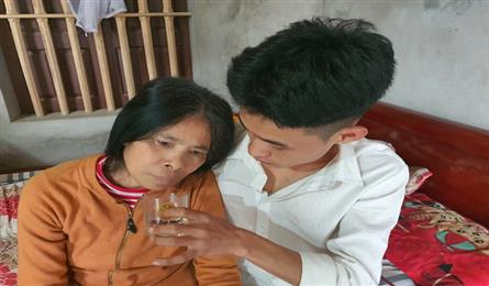 Young man taking care of ailing mother in dire need of help