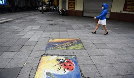 Manhole covers on Hanoi streets become works of art