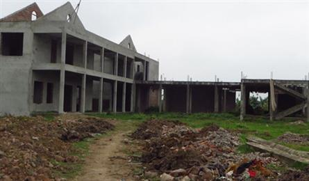 Students study in old warehouses in Hanoi as planned schools still not built