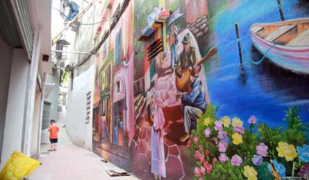 Houses in Hanoi alley decorated with mural