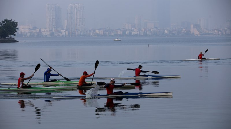 Rowers practice on West Lake