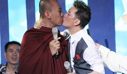 Jovial singer faces punishment for charity monk kiss
