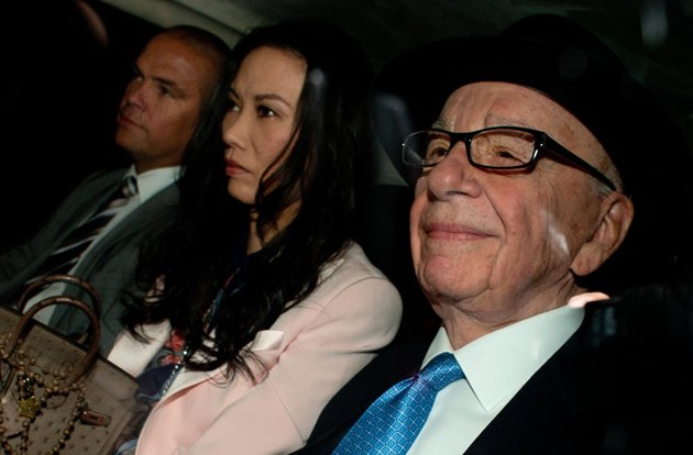 Murdochs in line for criticism in phone hacking report