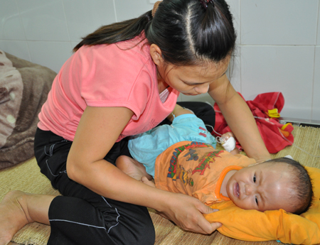 Hoang is rather ill Born over a month premature, Luong Huy Hoang had an abnormally large head and was constantly ill.