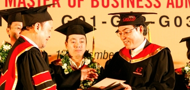 135 receive Masters degree