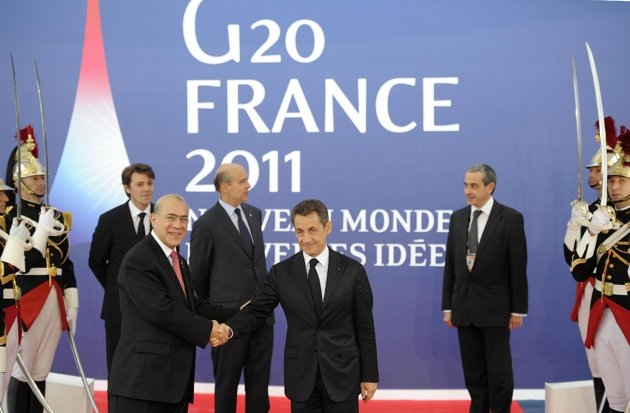 Secretary General of the Organisation for Economic Co-operation and Development Jose Angel Gurria (L) is welcomed by French President Nicolas Sarkozy as he arrives to attend the G20 Summit of Heads of State and Government in Cannes.