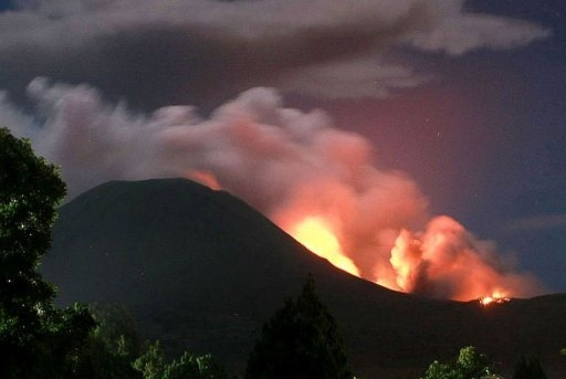 Indonesian volcano erupts, spewing rock and lava